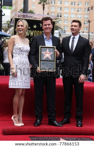 LOS ANGELES - MAY 23:  Carrie Underwood, Simon Fuller, Ryan Seacrest at the Simon Fuller Hollywood Walk Of Fame Star Ceremony at W Hotel - Hollywood on May 23, 2011 in Los Angeles, CA - stock photo