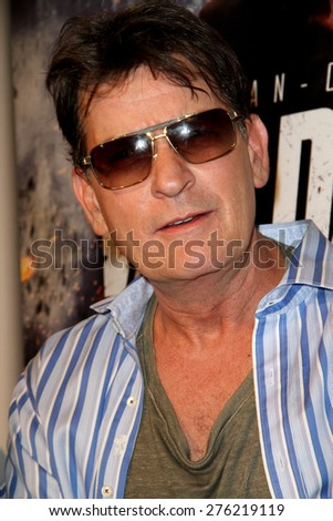 "LOS ANGELES - MAY 7: Charlie Sheen attends the premiere of ""Pound of Flesh"" at The Grove Pacific Theaters in Los Angeles on May 7, 2015.  - stock photo"