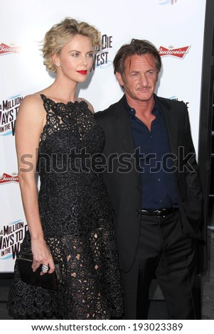 "LOS ANGELES - MAY 15:  Charlize Theron, Sean Penn at the ""A Million Ways To Die In The West"" World Premiere at Village Theater on May 15, 2014 in Westwood, CA - stock photo"