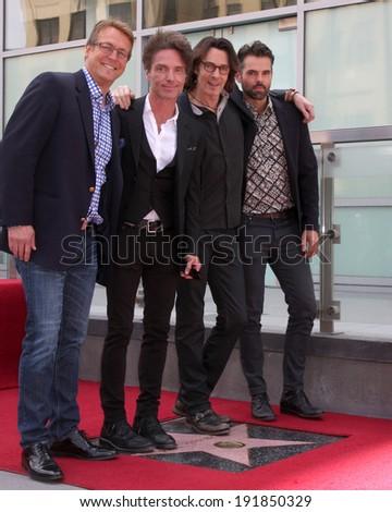LOS ANGELES - MAY 9:  Doug Davidson, Richard Marx, Rick Springfield, JasonThompson at the Rick Springfield Hollywood Walk of Fame Star Ceremony at Hollywood Blvd on May 9, 2014 in Los Angeles, CA - stock photo