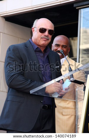 LOS ANGELES - MAY 13:  Dr. Phil McGraw, Steve Harvey at the Steve Harvey Hollywood Walk of Fame Star Ceremony at the W Hollywood Hotel  on May 13, 2013 in Los Angeles, CA - stock photo