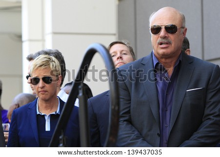 LOS ANGELES - MAY 13: Ellen DeGeneres, Dr Phil McGraw at a ceremony where Steve Harvey is honored with a star on the Hollywood Walk Of Fame on May 13, 2013 in Los Angeles, California - stock photo