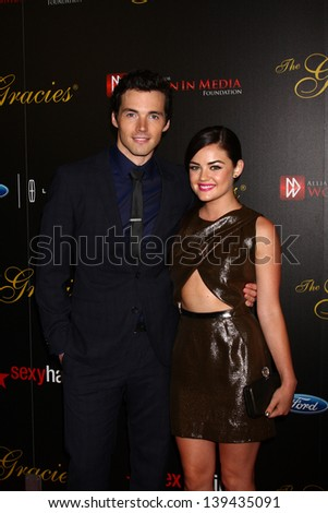 LOS ANGELES - MAY 21:  Ian Harding and Lucy Hale arrives at the 38th Annual Gracie Awards Gala at the Beverly Hilton Hotel on May 21, 2013 in Beverly Hills, CA - stock photo