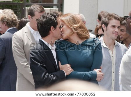 LOS ANGELES - MAY 23: Jennifer Lopez and Mark Antony kiss at Simon Fuller Hollywood Walk of Fame Star Ceremony at Hollywood Blvd on May 23, 2011 in Los Angeles, CA. - stock photo
