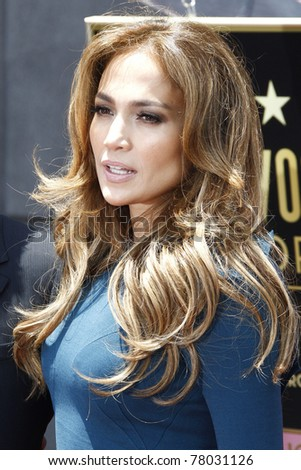 LOS ANGELES - MAY 23: Jennifer Lopez at a ceremony where Simon Fuller receives a star on the Hollywood Walk of Fame in Los Angeles, California on May 23, 2011.