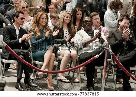 LOS ANGELES - MAY 23:  Jennifer Lopez, Randy Jackson, Mark Antony applaud during the Simon Fuller Hollywood Walk of Fame Star Ceremony at Hollywood Blvd on May 23, 2011 in Los Angeles, CA. - stock photo
