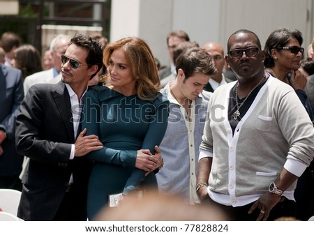 LOS ANGELES - MAY 23:  Jennifer Lopez, Randy Jackson, Mark Antony at the Simon Fuller Hollywood Walk of Fame Star Ceremony at Hollywood Blvd on May 23, 2011 in Los Angeles, CA. - stock photo