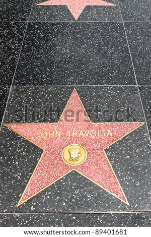 LOS ANGELES - MAY 18: John Travolta's star on the Hollywood Walk of Fame at Hollywood Blvd on May 18, 2009 in Hollywood, Los Angeles, CA. It is one of 2400 celebrity stars. - stock photo
