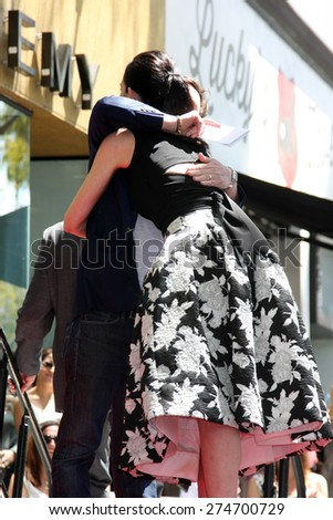 LOS ANGELES - MAY 1:  Michael J. Fox, Julianna Margulies at the Julianna Margulies Hollywood Walk of Fame Star Ceremony at the Hollywood Boulevard on May 1, 2015 in Los Angeles, CA - stock photo