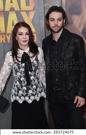 "LOS ANGELES - MAY 07:  Priscilla Presley & Navarone Garibaldi arrives to the ""Mad Max: Fury Road"" Los Angeles Premiere  on May 7, 2015 in Hollywood, CA                 - stock photo"
