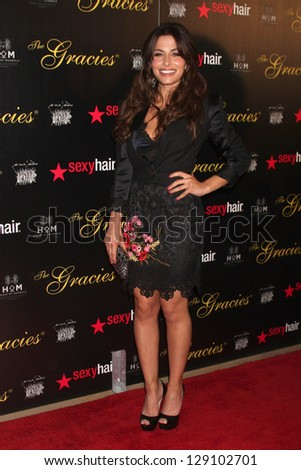 LOS ANGELES - MAY 22:  Sarah Shahi arrives at the 37th Annual Gracie Awards Gala at Beverly Hilton Hotel on May 22, 2012 in Beverly Hills, CA - stock photo