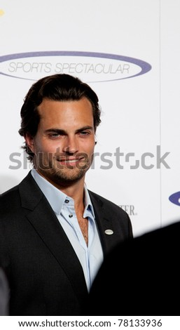 LOS ANGELES - MAY 22: Scott Elrod arrives at 2011 Cedars Sinai Sports Spectacular Los Angeles, CA on May 12, 2011. - stock photo