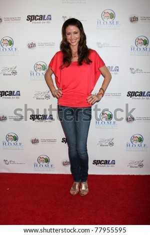 LOS ANGELES - MAY 24:  Shannon Elizabeth. arriving at the Celebrity Casino Royale Event at Avalon on May 24, 2011 in Los Angeles, CA