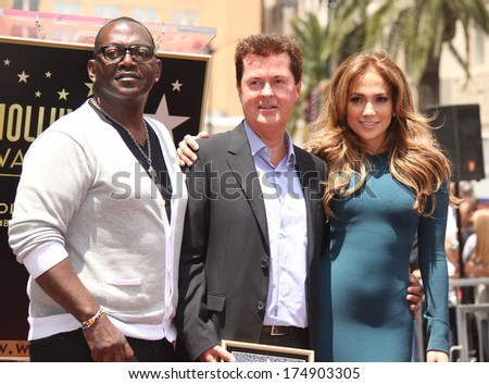 LOS ANGELES - MAY 23:  Simon Fuller, Randy Jackson & Jennifer Lopez arrives to the Walk of Fame Ceremony for Simon Fuller  on May 23, 2011 in Hollywood, CA                 - stock photo