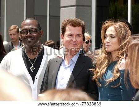 LOS ANGELES - MAY 23: Simon Fuller with Jennifer Lopez and Randy Jackson at his  Hollywood Walk of Fame Star Ceremony at Hollywood Blvd on May 23, 2011 in Los Angeles, CA. - stock photo