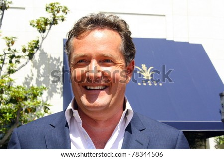 LOS ANGELES - MAY 31: Talk show host Piers Morgan after his appearance on Extra with Mario Lopez at The Grove on May 31, 2011 Los Angeles, CA. - stock photo