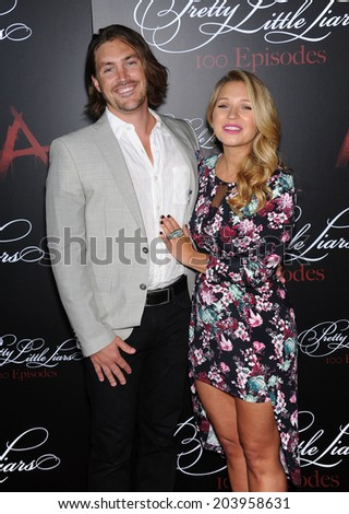 "LOS ANGELES - MAY 31:  Vanessa Ray & Landon Beard arrives to the ""Pretty Little Liars"" 100th Episode Celebration  on May31, 2014 in Hollywood, CA."