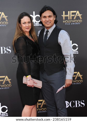 LOS ANGELES - NOV 14:  Adam Beach arrives to the The Hollywood Film Awards 2014 on November 14, 2014 in Hollywood, CA                 - stock photo