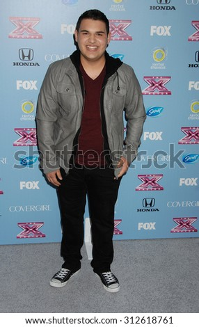 LOS ANGELES - NOV 4:  Carlos Guevara arrives at 2013 The X Factor Top 12 Finalists  Premiere  on November 4, 2013 in Beverly Hills, CA                 - stock photo