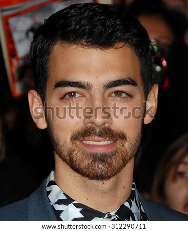 LOS ANGELES - NOV 18:  Joe Jonas arrives at the The Hunger Games Catching Fire US Premiere  on November 18, 2013 in Los Angeles, CA                 - stock photo