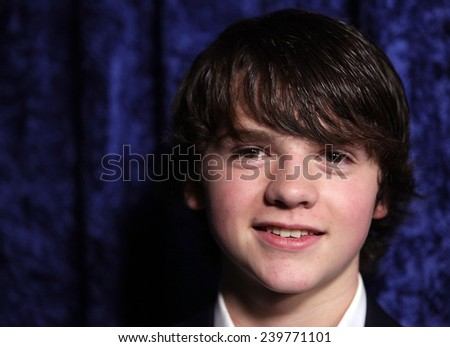 """LOS ANGELES - NOV 22:  JOEL COURTNEY arrives to the """"Super 8"""" DVD Launch  on November 22, 2011 in Beverly Hills, CA                 - stock photo"""