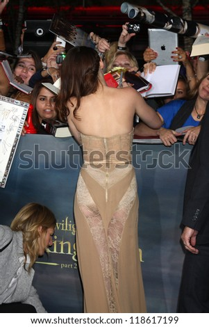 "LOS ANGELES - NOV 12:  Kristen Stewart signing autographs as she arrives to the 'The Twilight Saga: Breaking Dawn - Part 2"" Premiere at Nokia Theater on November 12, 2012 in Los Angeles, CA - stock photo"