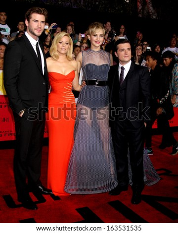 LOS ANGELES - NOV 18:  Liam Hemsworth, Elizabeth Banks, Jennifer Lawrence, Josh Hutcherson at the The Hunger Games:  Catching Fire Premiere at Nokia Theater on November 18, 2013 in Los Angeles, CA - stock photo