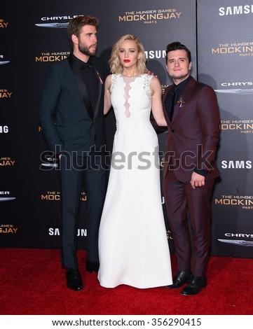 "LOS ANGELES - NOV 16:  Liam Hemsworth, Jennifer Lawrence & Josh Hutchinson at  ""The Hunger Games: Mocking Jay - Part 2"" Los Angeles Premiere  on November 16, 2015 in Los Angeles, CA.                 - stock photo"