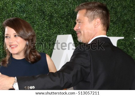 "LOS ANGELES - NOV 9:  Marion Cotillard, Brad Pitt at the ""Allied"" Fan Screening at the Village Theater on November 9, 2016 in Westwood, CA"