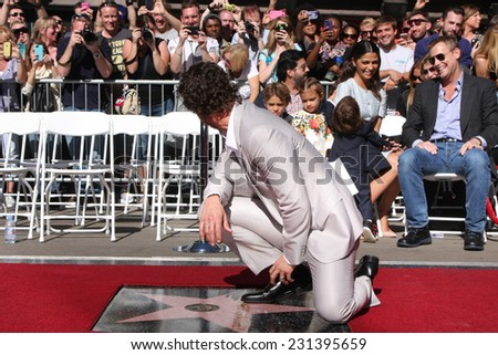 LOS ANGELES - NOV 17:  Matthew McConaughey, family in background at the Matthew McConaughey Hollywood Walk of Fame Star Ceremony at the Hollywood & Highland on November 17, 2014 in Los Angeles, CA - stock photo