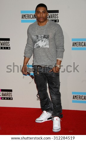 LOS ANGELES - NOV 24:  Nelly arrives at the 2013 American Music Awards Arrivals  on November 24, 2013 in Los Angeles, CA                 - stock photo