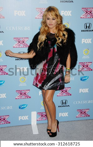 LOS ANGELES - NOV 4:  Paulina Rubio arrives at 2013 The X Factor Top 12 Finalists  Premiere  on November 4, 2013 in Beverly Hills, CA                 - stock photo