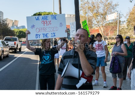 LOS ANGELES - NOV 02: Protesters rallied in the streets against corruption on November 02, 2013 in Los Angeles, California - stock photo