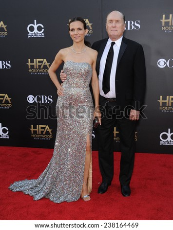 LOS ANGELES - NOV 14:  Robert Duvall & Luciana Pedraza arrives to the The Hollywood Film Awards 2014 on November 14, 2014 in Hollywood, CA                 - stock photo