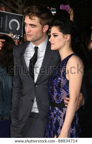 "LOS ANGELES - NOV 14:  Robert Pattinson, Kristen Stewart arrives at the ""Twilight: Breaking Dawn Part 1"" World Premiere at Nokia Theater at LA LIve on November 14, 2011 in Los Angeles, CA - stock photo"
