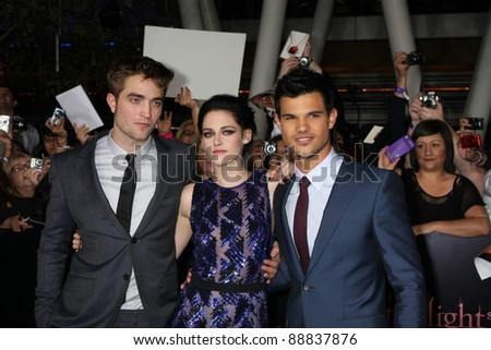 "LOS ANGELES - NOV 14:Robert Pattinson, Kristen Stewart, Taylor Lautner arrive at the ""Twilight: Breaking Dawn Part 1"" World Premiere at Nokia Theater at LA LIve on November 14, 2011 in Los Angeles, CA - stock photo"
