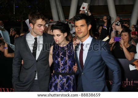 "LOS ANGELES- NOV 14: Robert Pattinson, Kristen Stewart, Taylor Lautner arrive at the ""Twilight: Breaking Dawn Part 1"" World Premiere at Nokia Theater at LA LIve on November 14, 2011 in Los Angeles, CA - stock photo"