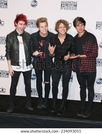 LOS ANGELES - NOV 23:  5 Seconds of Summer at the 2014 American Music Awards - Press Room at the Nokia Theater on November 23, 2014 in Los Angeles, CA - stock photo