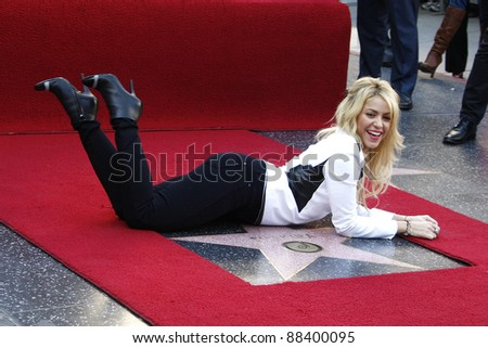 LOS ANGELES - NOV 8: Shakira receives a star on the Hollywood Walk of Fame on November 8, 2011 in Los Angeles, California - stock photo