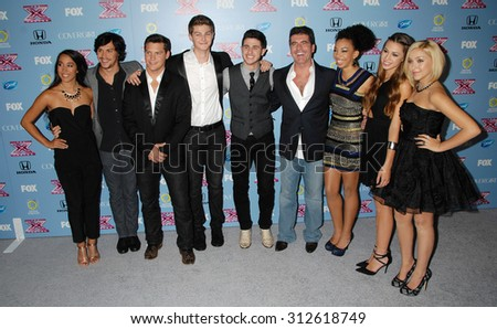 LOS ANGELES - NOV 4:  Simon Cowell, Alex and Sierra, Restless Road and Sweet Suspense arrives at 2013 The X Factor Top 12 Finalists  Premiere  on November 4, 2013 in Beverly Hills, CA                 - stock photo