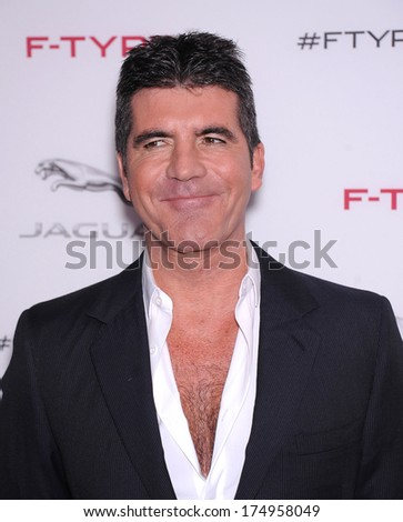 LOS ANGELES - NOV 19:  Simon Cowell arrives to the Jaguar F-TYPE Global Reveal Event  on November 19, 2013 in Playa Vista, CA