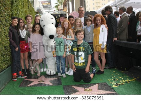 "LOS ANGELES - NOV 2:  Snoopy, Voice cast of ""The Peanuts Movie"" at the Snoopy Hollywood Walk of Fame Ceremony at the Hollywood Walk of Fame on November 2, 2015 in Los Angeles, CA - stock photo"