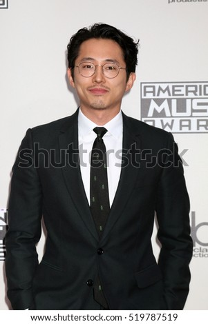 LOS ANGELES - NOV 20:  Steven Yeun at the 2016 American Music Awards at Microsoft Theater on November 20, 2016 in Los Angeles, CA