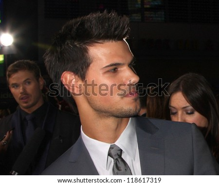 "LOS ANGELES - NOV 12:  Taylor Lautner arrive to the 'The Twilight Saga: Breaking Dawn - Part 2"" Premiere at Nokia Theater on November 12, 2012 in Los Angeles, CA - stock photo"