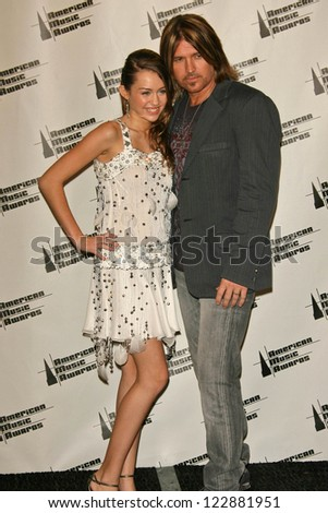 LOS ANGELES - NOVEMBER 21: Billy Ray Cyrus and Miley Cyrus in the press room at the 34th Annual American Music Awards at Shrine Auditorium on November 21, 2006 in Los Angeles, CA. - stock photo
