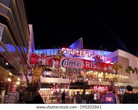 LOS ANGELES - NOVEMBER 25: Fans enter arena and pose for photos with statues  during Clippers game on November 25, 2010 in Los Angeles. Entrance of the Staples Center at night. - stock photo