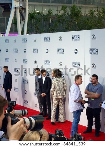 LOS,ANGELES - NOVEMBER 22, 2015: Liam Payne,Harry Styles,Louis Tomlinson and Niall Horan of One Direction walk the Red Carpet of the 2015 American Music Awards at the Microsoft Theater.  - stock photo