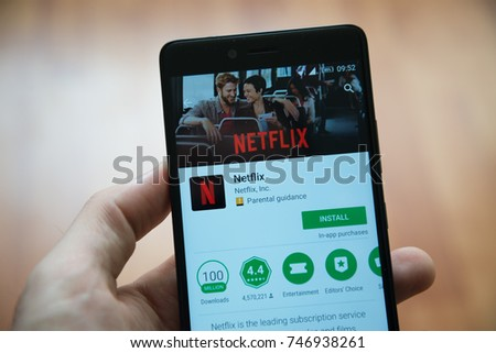 Los Angeles, november 2, 2017: Man hand holding smartphone with Netflix application in google play store