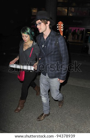 LOS ANGELES-NOVEMBER 1: Twilight actor Jackson Rathbone with girlfriend arrive at LAX airport, November 1, 2011 in Los Angeles, California