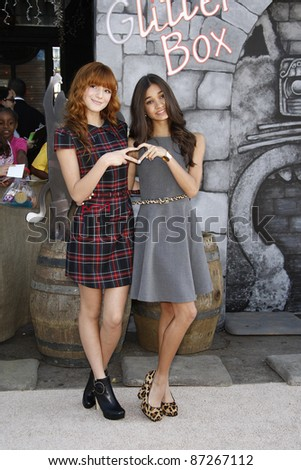 LOS ANGELES - OCT 23: Bella Thorne; Pia Mia at the premiere of Dreamworks 'Puss In Boots' at the Regency Westwood Theater on October 23, 2011 in Los Angeles, California - stock photo